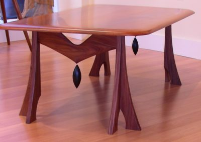 Coffee Table made with a Pear top and Bolivian Rosewood base with solid bony dangles